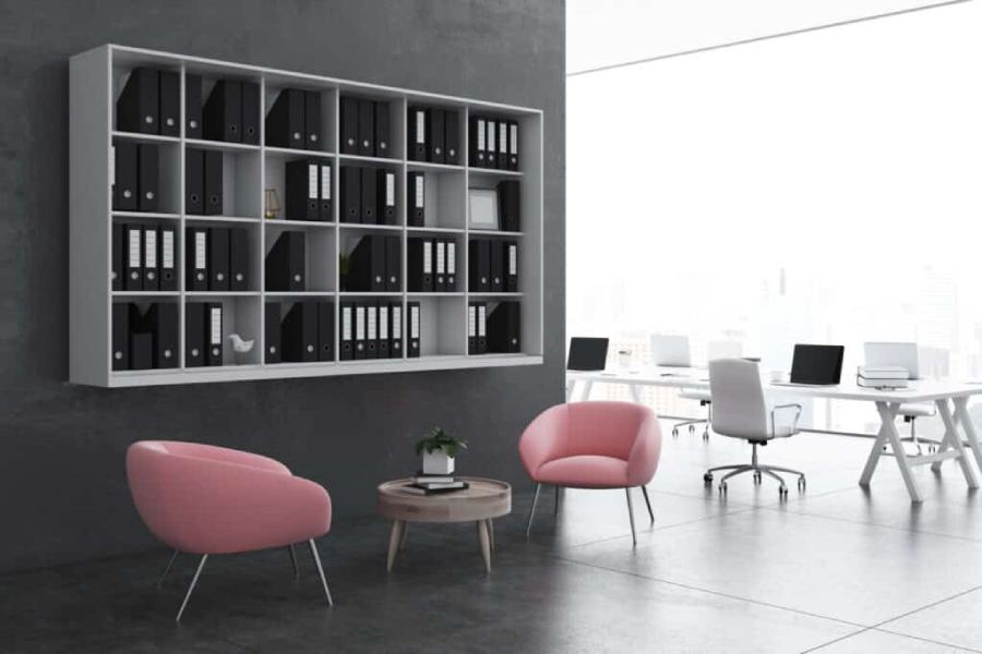 Modern Office Waiting Room With Soft Pink Armchairs Near A Coffe